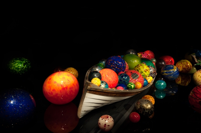 Dale Chihuly Float Boat.  This was shown in a dark room with only the illuminus of the art work on a mirrored floor.  I was able to capture this image without a flash using RAW format.